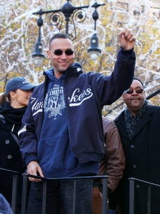 New York Yankees shortstop Derek Jeter, Minka Kelly and Jeter's father, S. Charles Jeter attend 2009 New York Yankees World Series Victory Parade, NYC, November 6, 2009