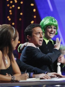Kelly Osbourne sits on Bruno Tonioli's lap after receiving high praise on 'Dancing,' Nov. 9, 2009