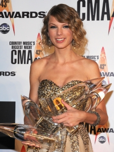 Taylor Swift poses with her four CMA Awards, Nashville, Nov. 11, 2009