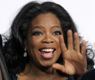 Oprah Winfrey, executive producer of 'Precious: Based on the Novel 'Push' by Sapphire,' waves to photographers at the premiere of the film at AFI Fest 2009 in Los Angeles, Sunday, Nov. 1, 2009.