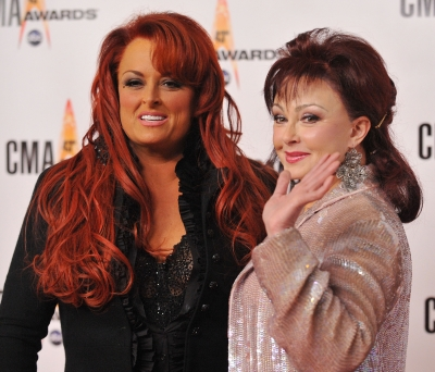Wynonna Judd and Naomi Judd of The Judds arrive at the 43rd Annual CMA Awards at the Sommet Center on November 11, 2009 in Nashville, Tennessee