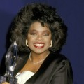 Oprah Winfrey grins as she holds a statute at the 14th Annual People's Choice Awards, Mar. 13, 1988