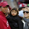 Tiger Woods, Sam Woods and Elin Nordegren look on at the Stanford-Cal game on November 21, 2009