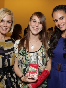 Jennie Garth and Jordana Brewster pose with former Children's Hospital LA patient Briana at the Lollipop Theater Network's launch party for 'La Collection Lollipop' by Lancome on November 17, 2009 in LA