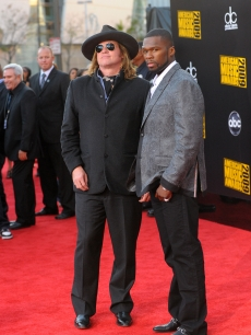 Val Kilmer and 50 Cent make an odd couple at the 2009 American Music Awards at the Nokia Theatre L.A. Live in LA on November 22, 2009