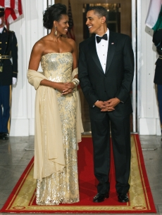 First Lady Michelle Obama and President Barack Obama pose before the White House State Dinner on November 24, 2009