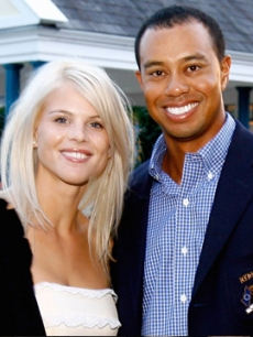 Elin Nordegren and Tiger Woods pose in September 2006