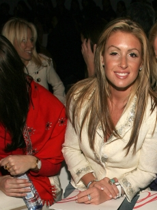 Rachel Uchitel attends Olympus Fashion Week in Bryant Park, NYC, February 9, 2005