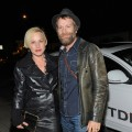 Patricia Arquette and a shoeless Thomas Jane arrive in an Audi TDI to the Galerie Half Grand Opening Party, Los Angeles, December 10, 2009
