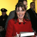 Sarah Palin signs her new book, &#8216;Going Rogue&#8217; for a customer at a Barnes &amp; Noble bookstore, Grand Rapids, Michigan, November 18, 2009