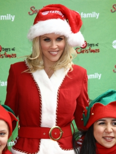 Jenny McCarthy (in a Santa suit) attends the ABC Family's world record elf party to promote 'Santa Baby 2: Christmas Maybe' at Bryant Park, NYC, December 7, 2009