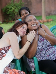 Debra Messing, left, visits members of the gay community in Harare, Uganda, Tuesday, Dec. 8, 2009. Messing who is best known for her role on NBC's Emmy Award winning comedy series, 'Will and Grace' is in Zimbabwe to attend an HIV and AIDS Awards ceremony and is also set to visit a number of HIV prevention and treatment centers in the country.
