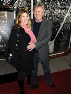 Gary Busey and Steffanie Sampson arrive at the premiere Of Fox Searchlight's 'Crazy Heart' on December 8, 2009 at the Academy of Motion Picture Arts and Sciences in Beverly Hills, California