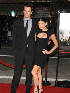 Fergie looks chic alongside her husband Josh Duhamel at the red carpet arrivals for a special screening of 'Nine' in Westwood, California, on December 9, 2009