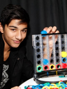 Mark Indelicato of 'Ugly Betty' had fun playing Hasbro Family Game Night's new Connect 4x4 backstage, and admitted to already having a game closet full of Hasbro games!