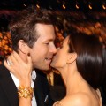 Ryan Reynolds shares a kiss with his 'Proposal' co-star, Sandra Bullock, at the 2010 People's Choice Awards, LA, Jan. 6, 2010
