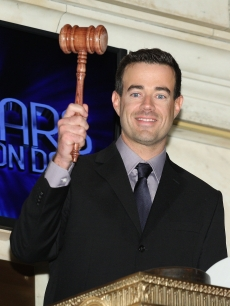 Carson Daly rings the closing bell at the New York Stock Exchange on December 30, 2009