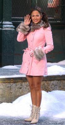 Jennifer Lopez waves to fans while standing in snow on the set of her music video, NYC, November 20, 2002
