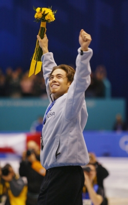 Apolo Anton Ohno of the USA celebrates before receiving the silver medal in the men's 1000m speed skating during the Salt Lake City Winter Olympic Games at the Salt Lake Ice Center in Salt Lake City, Utah, Feb. 16, 2002
