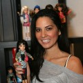 Olivia Munn plays around with a Liv fashion doll at Access Hollywood&#8217;s 4th Annual &#8216;Stuff You Must&#039; Golden Globes Gifting Lounge at the Sofitel Hotel in LA on January 16, 2010