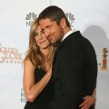 Jennifer Aniston and Gerard Bulter get cozy backstage in the photo room at the 67th Annual Golden Globe Awards at the Beverly Hilton Hotel in Beverly Hills, California, January 17, 2010