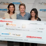 Kate Walsh and Shenae Grimes present the CVS Pharmacy donation to Access Hollywood's Billy Bush and the Lollipop Theater Network at Access' 4th Annual 'Stuff You Must…' Golden Globes Gifting Lounge at the Sofitel Hotel in LA on January 16, 2010