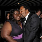 Precious' star Gabourey Sidibe gets a kiss from director Lee Daniels at the Lionsgate Golden Globe Party at Polo Lounge at The Beverly Hills Hotel on January 16, 2010 in Beverly Hills, Calif.