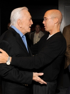 "Jeffrey Katzenberg shakes the hand of Kirk Douglas, someone he calls both a legend and a mentor, at the Motion Picture & Television Fund's LA premiere of ""Before I Forget"""