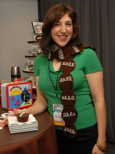 'Blossom' star Mayim Bialik poses with a Hostess Cupcakes Nostalgic Lunchbox at Access Hollywood's 4th Annual 'Stuff You Must…' Golden Globes Gifting Lounge at the Sofitel Hotel in LA on January 15, 2010