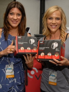 'Dexter' stars Jennifer Carpenter and Julie Benz are all smiles with their Vue by Avaak Personal Video Networks at Access Hollywood's 4th Annual 'Stuff You Must…' Golden Globes Gifting Lounge at the Sofitel Hotel in LA on January 16, 2010