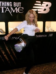 Kym Johnson kicks into action with New Balance Fierce Trax Collection shoes at Access Hollywood's 4th Annual 'Stuff You Must…' Golden Globes Gifting Lounge at the Sofitel Hotel in LA on January 16, 2010