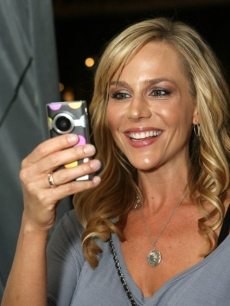 "'Dexter's' Julie Benz checks out the Flip Video MiniHD camera at Access Hollywood's 4th Annual ""Stuff You Must…"" lounge produced by On 3 Productions celebrating the Golden Globes"