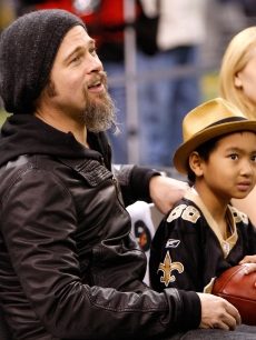 Brad Pitt, son Maddox Jolie-Pitt and actress Patricia Clarkson at New Orleans Saints game at Louisana Superdome on January 16, 2010 in New Orleans, Louisiana