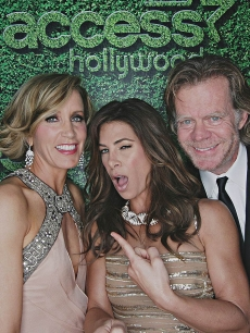 Felicity Huffman and husband William H. Macy pose with Jillian Michaels inside Access' Usnaps photo booth at the 2010 Golden Globes