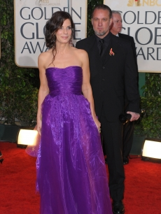 Sandra Bullock and Jesse James arrive at the 67th Annual Golden Globe Awards held at The Beverly Hilton Hotel on January 17, 2010 in Beverly Hills