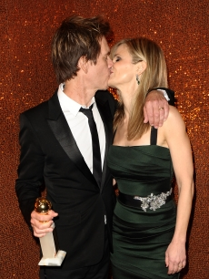 Golden Globe winner Kevin Bacon and wife Kyra Sedgwick share a kiss at HBO's Globes after party at Circa 55 Restaurant at the Beverly Hilton Hotel on January 17, 2010 in Beverly Hills