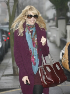 Claudia Schiffer, who is expecting her third child, smiles as she steps out in London, Jan. 18, 2010