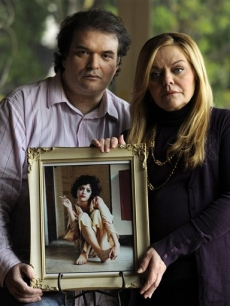 Simon Monjack, husband of deceased actress Brittany Murphy, and Murphy's mother Sharon pose with a portrait of the actress, in Los Angeles, Tuesday, Jan. 19, 2010