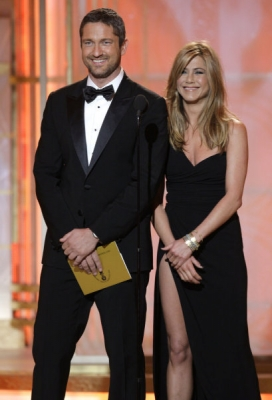 Gerard Butler shares a laugh with Jennifer Aniston on the Golden Globe stage, Beverly Hills, Jan. 17, 2010