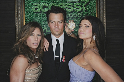 Jillian Michaels poses with Josh Duhamel and Fergie inside Access' Usnaps photo booth at the 2010 Golden Globes