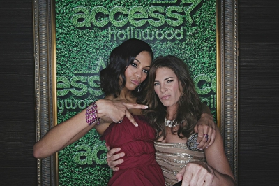 'Avatar' star Zoe Saldana mugs with Jilian Michaels inside Access' Usnaps photo booth at the 2010 Golden Globes