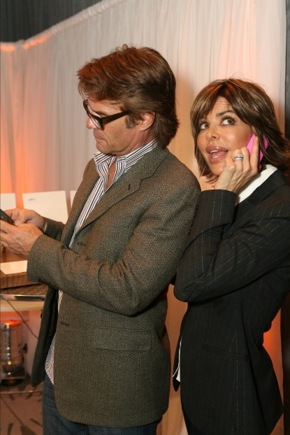 Lisa Rinna and Harry Hamlin call the shots with their Palm Pixi phones at Access Hollywood's 4th Annual 'Stuff You Must…' Golden Globes Gifting Lounge at the Sofitel Hotel in LA on January 15, 2010