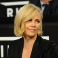 Charlize Theron fields calls at the &#8216;Hope for Haiti Now: A Global Benefit for Earthquake Relief&#8217; event, Los Angeles, Jan. 22, 2010