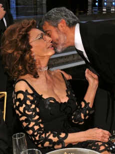 George Clooney gives Sophia Loren a kiss during the 16th Annual Screen Actors Guild Awards at the Shrine Auditorium on January 23, 2010 in Los Angeles, California