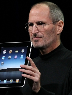 Apple Inc. CEO Steve Jobs holds up the new iPad as he speaks during an Apple Special Event at Yerba Buena Center for the Arts January 27, 2010 in San Francisco, Calif.