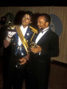 Michael Jackson and Quincy Jones pose at the 26th Annual Grammy Awards in Los Angeles, Calif., February 28, 1984