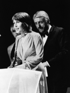 Helen Reddy accepts the Grammy Award for Best Female Song of the Year in Nashville, Tenn., March 3, 1973
