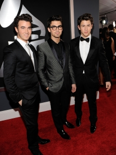 Kevin Jonas, Joe Jonas and Nick Jonas of the Jonas Brothers arrives at the 52nd Annual Grammy Awards held at Staples Center on January 31, 2010 in Los Angeles, California