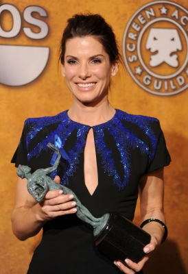 Sandra Bullock smiles with her award for Outstanding Female Actor in a Leading Role for 'The Blind Side' at the 16th Annual Screen Actors Guild Awards at the Shrine Auditorium in LA on January 23, 2010