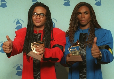 Rob Pilatus and Fab Morvan of Milli Vanilli pose with their Grammys after being presented with the 1989 Best New Artist award in Los Angeles, Calif., February 21, 1990